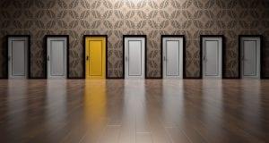Different grey doors with one yellow door